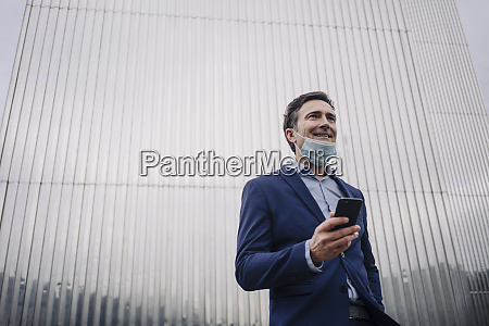 smiling mature businessman with protective face