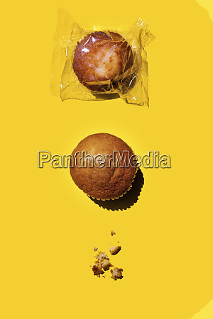 studio shot of two muffins and
