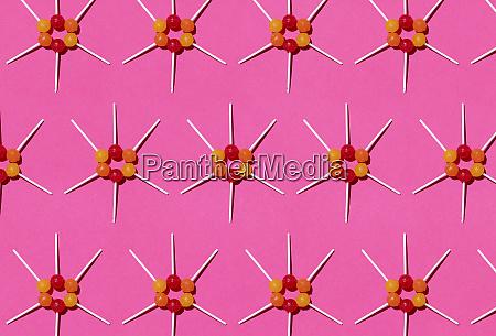 pattern of lollipops against pink background