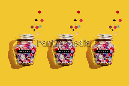 three jars of colorful confetti