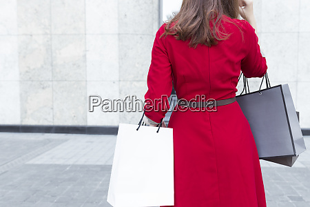 young woman carrying shopping bags while