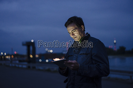 mature man using tablet at the