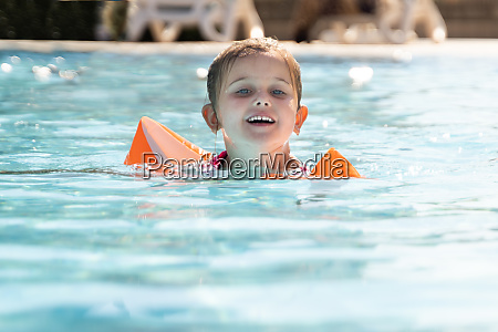 child girl in swimming pool playing