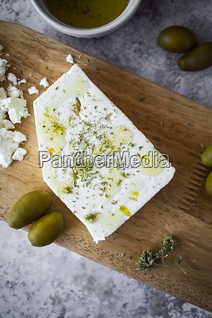 cutting board with feta cheese and