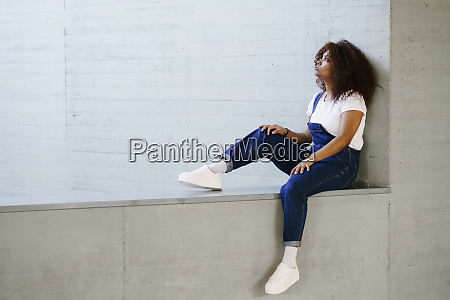 thoughtful young woman with afro hair
