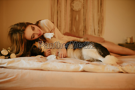 happy blond woman lying in bed