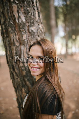 side view portrait of smiling young
