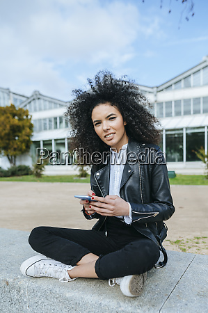 young woman with afro hairstyle using
