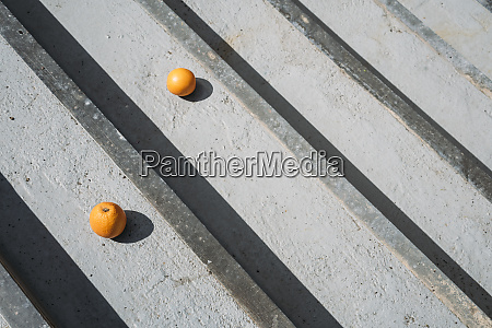oranges on gray wood boards