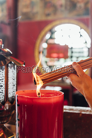 malaysia hand of woman burning incense