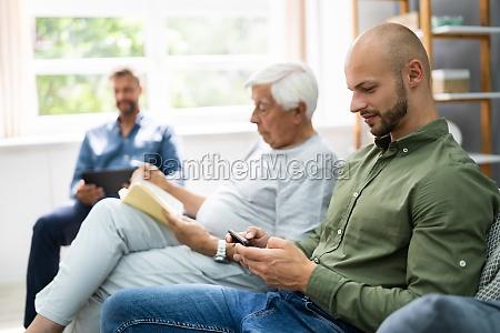 three generation men spending time together