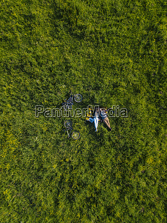 couple lying on grass aerial view