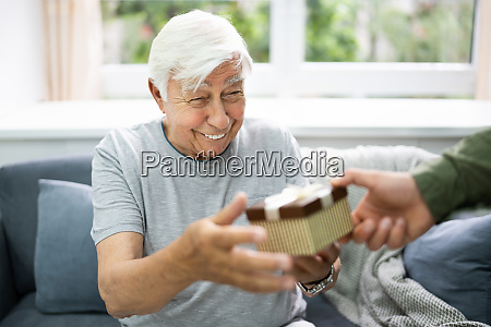 senior citizen receiving celebration gift