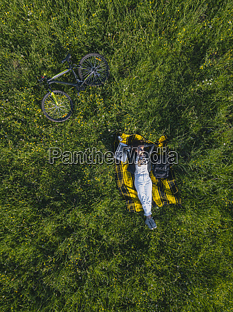 woman lying on grass aerial view