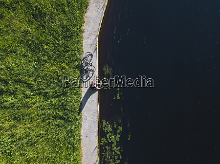 drone shot of man with bicycle