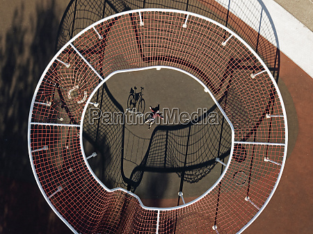 man with bicycle in sports field