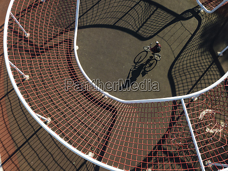 man cycling in sports field aerial
