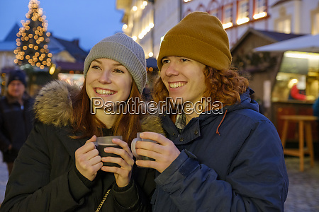 happy young couple holding coffee cups