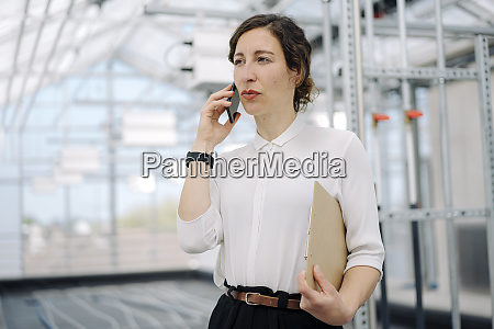 serious businesswoman with clipboard on the