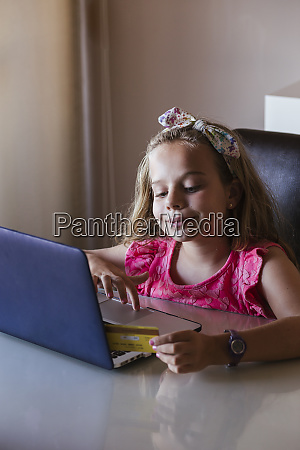 girl using laptop at home and
