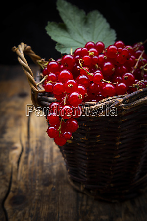 small wicker basket with ripe red