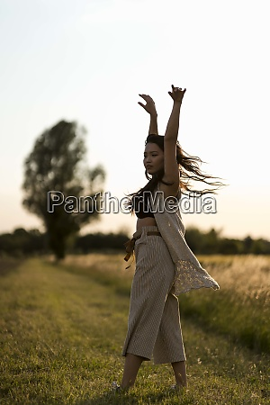 woman dancing at field in the