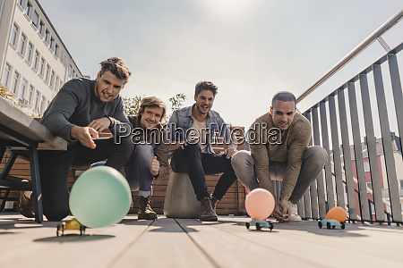 group of friends making a toy