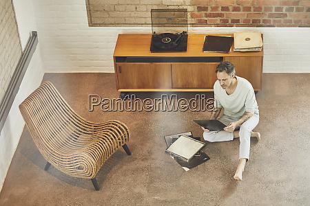 senior man in a loft flat