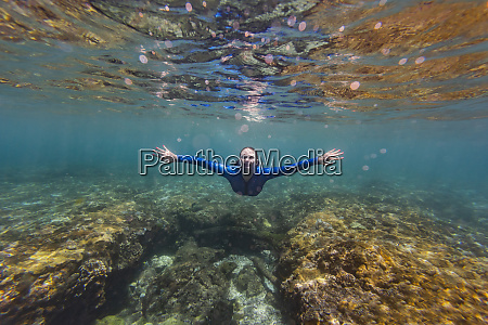 indonesia bali young woman snorkeling in
