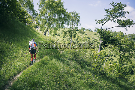 hiker walking on mountain path orobie