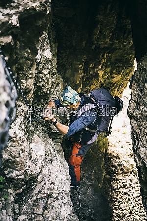 mountaineer climbing on via ferrata orobie