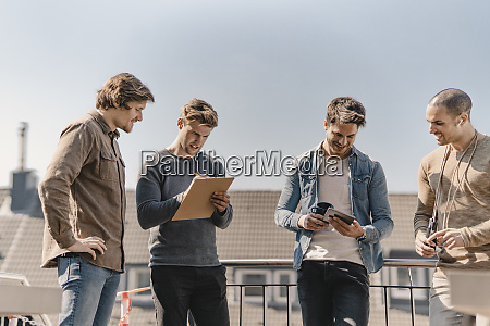 young entrepreneurs brainstorming on a roof