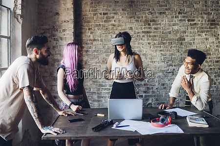 creative team using vr goggles in