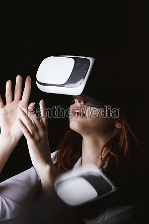 young woman gesturing while using vr