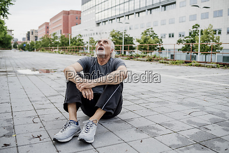 tired senior man with mouth open