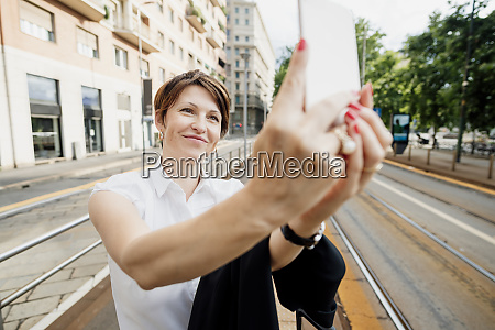 close up of smiling businesswoman taking