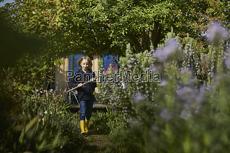 girl in allotment garden holding a