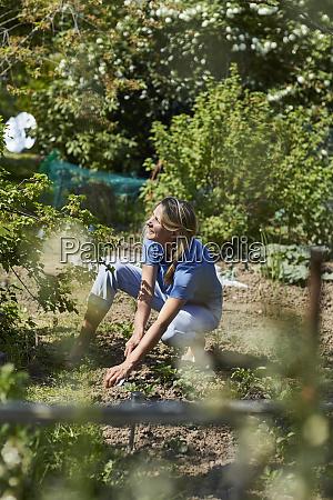 woman working in allotment garden