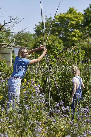 mother and daughter in allotment garden