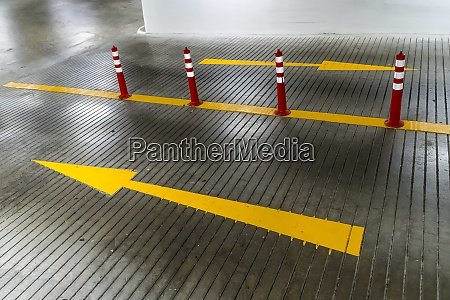 yellow arrows and traffic cones on