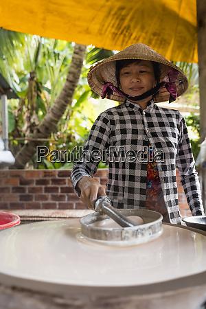 woman producing noodles at home ho