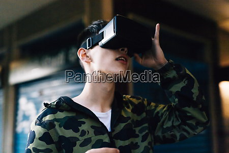 young man looking through virtual reality