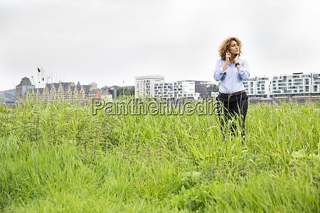 female entrepreneur with curly hair talking