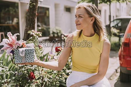 smiling woman handing over gift