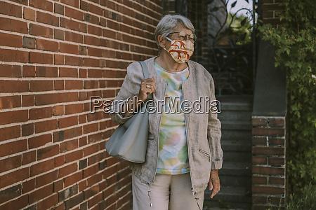 retired senior woman wearing face mask