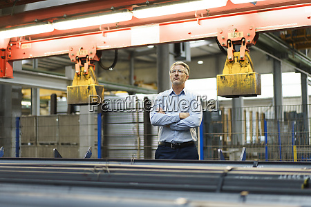 confident mature businessman standing in a