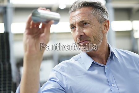 businessman holding steel pipe in a