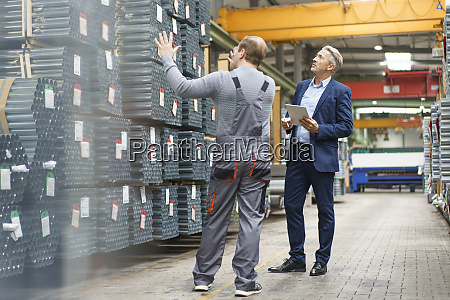 businessman and worker talking in a