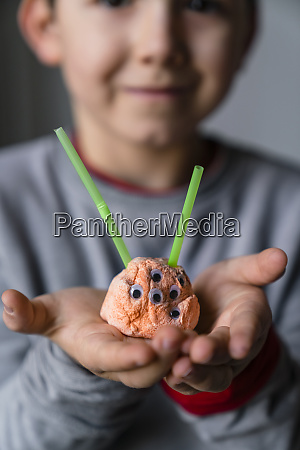 close up of boy holding toy