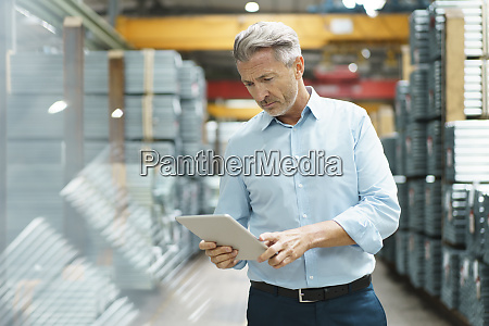 mature businessman using tablet in a